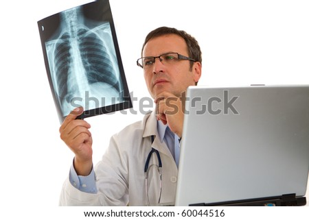 Male doctor looking at a lungs or torso x-ray image
