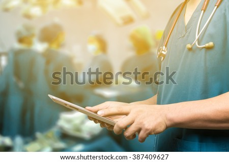 Male doctor,medical students or surgeon using digital tablet and laptop during the conference,Health Check with digital system support for patient,test results and patient registration,selective focus