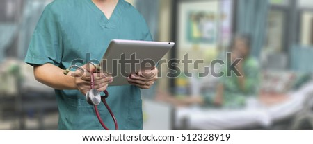 Male doctor,medical students or surgeon usingl tablet and laptop during the conference,Health Check with digital system support for patient,test results and data registration,selective focus