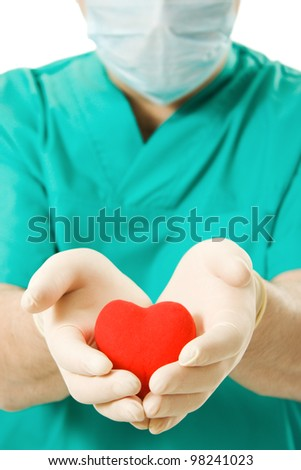Male doctor with a heart in his hands on a white background.
