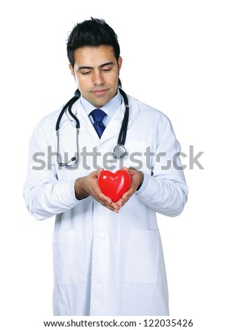 Male doctor with stethoscope holding heart, isolated on white background