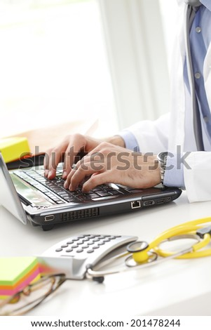Male doctor working at private clinic.