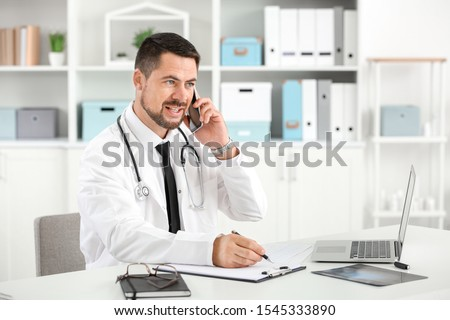 Male doctor working in clinic