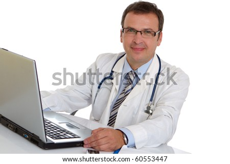 Male doctor write medical reports - at work use laptop