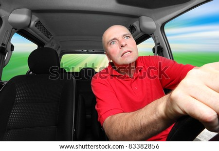Male driver riding his car.