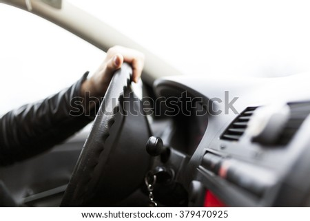 Male driving car close up driver hand selective focus