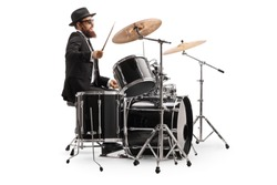 Male drummer in a suit playing with drumsticks isolated on white background