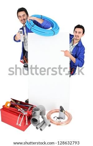 male duo of plumbers with tools