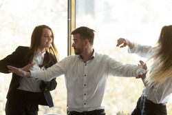 Male employee set apart angry female colleagues fight quarrel at office meeting, furious angry woman coworkers dispute shout having conflict or controversy at meeting, competition, rivalry concept