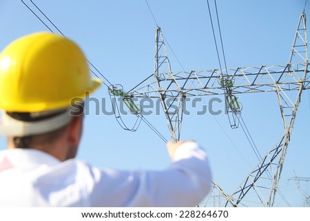 Male engineer standing at electricity station