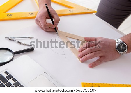 Male engineer working on drawings and blueprints #665913109