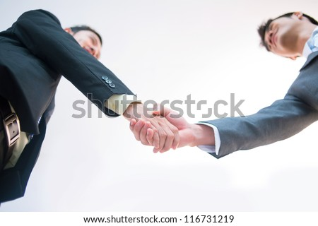 Male entrepreneurs greeting each other to lay the foundation for fruitful cooperation