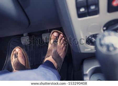 Male Feet On The Pedals Of A Car Stock Photo 153290408
