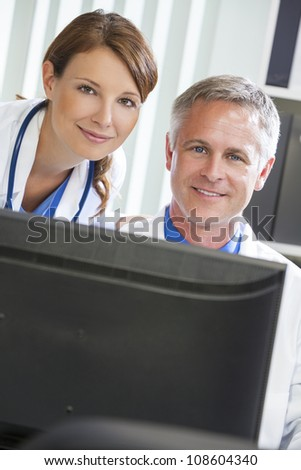 Male & female medical doctors using computer in a hospital office