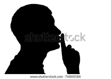 Male figure in silhouette gesturing for quiet...  Shhhhh