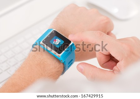 Male finger tap on the icon of unread messages on the smart watch