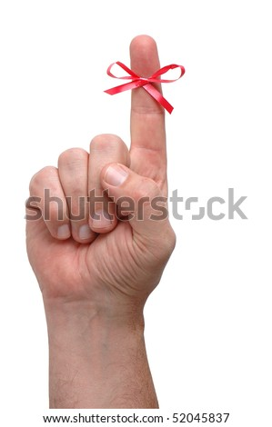 Male finger with a red ribbon