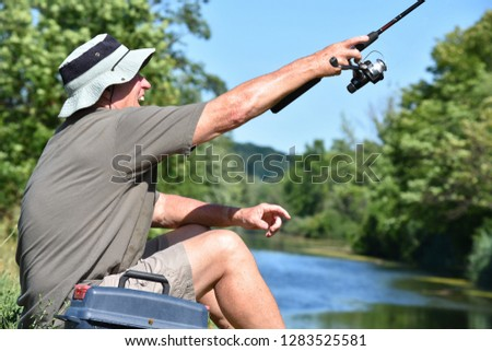Male Fisherman And Excitement With Fishing Rod Casting Rod #1283525581