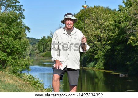 Male Fisherman Outdoors With Fishing Rod Fishing #1497834359