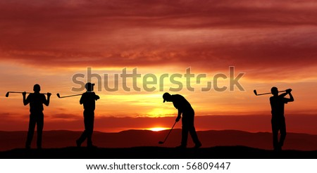 Male golfers at sunset