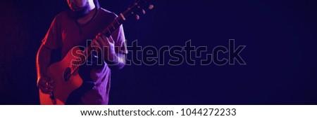 Male guitarist performing at nightclub