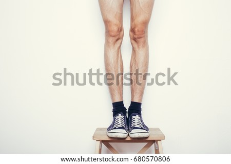 male hairy legs. skinny legs guy. white background. effects of diet #680570806