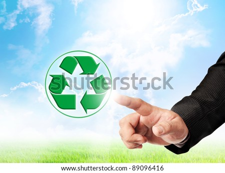 Male hand and recycle sign on nature background for green world concept