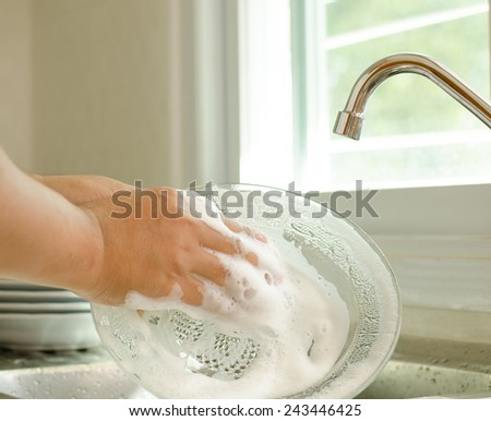 Male hand cleaning dish