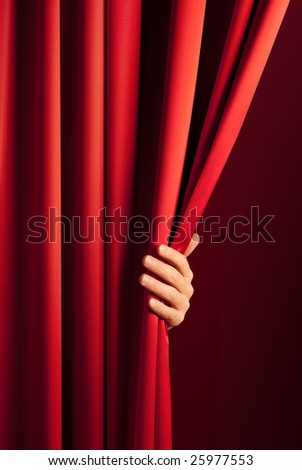 male hand disclose the scene shifting the red curtain