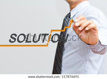 Male hand drawing a business chart
