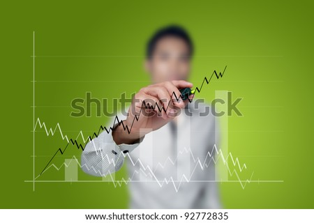 Male hand drawing a graph.