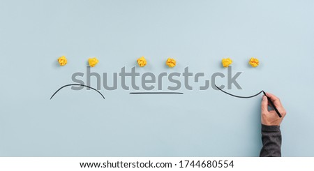 Male hand drawing a smiling, neutral and sad face in a conceptual image of customer feedback and review. Photo stock ©