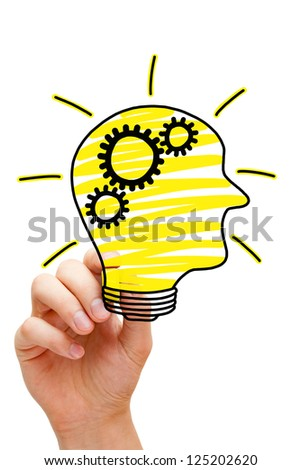 Male hand drawing human head in the shape of a light bulb on transparent wipe board.