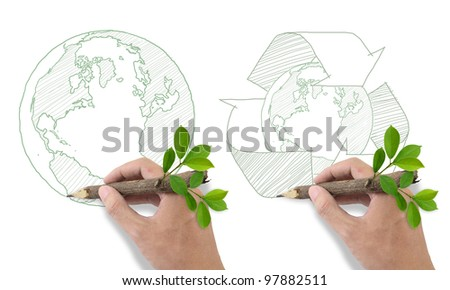 Male hand drawing recycle and world symbol.