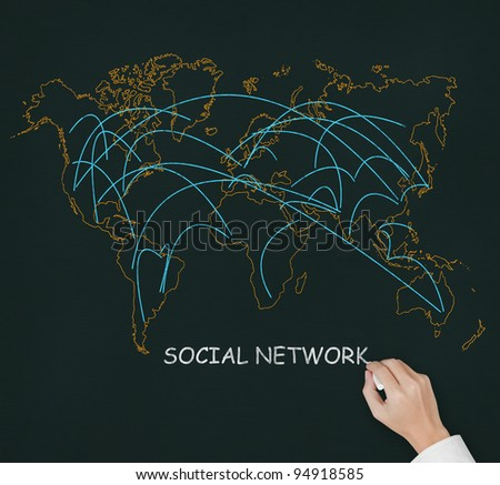 male hand drawing social network link on world map