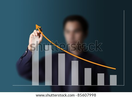 male hand drawing upward trend graph