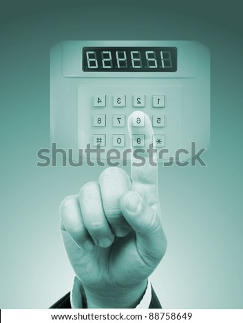 male hand entering safe or door code