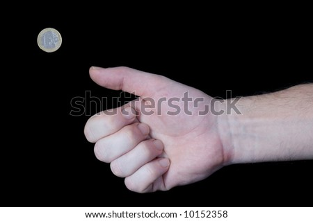 Male hand flipping away one Euro coin with thumb.