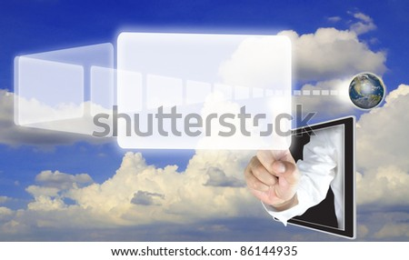 male hand from tablet push a transparent button fly from earth globe