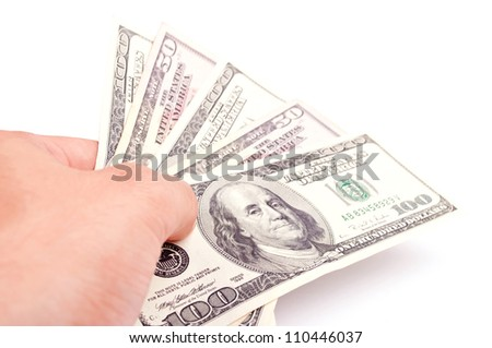 Male hand giving American Dollar-bills, isolated on white - stock photo