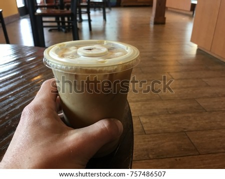 Male hand grabbing Ice coffee in the morning my daily routine from my perspective #757486507