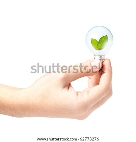 Male hand holding a light bulb with fresh green leaves inside, isolated on white background