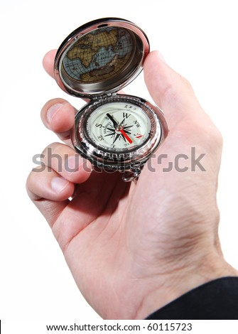 Male hand holding a silver vintage-style compass, isolated on a white background
