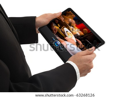 male hand holding a touchpad pc showing a movie, isolated on white