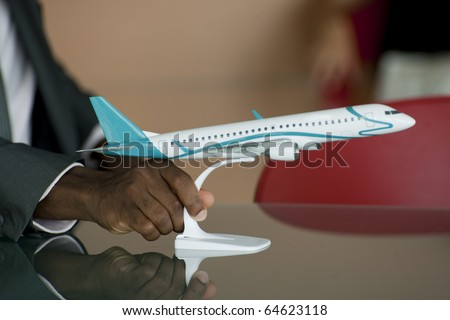 Male Hand holding airplane model