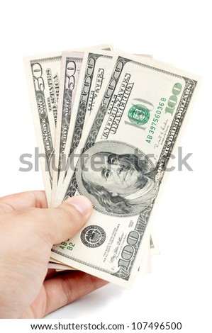 Male hand holding american Dollar-bills, isolated on white