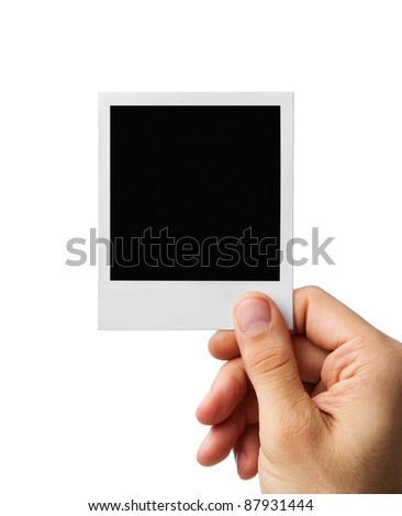 Male hand holding blank instant photo frame, clipping path included