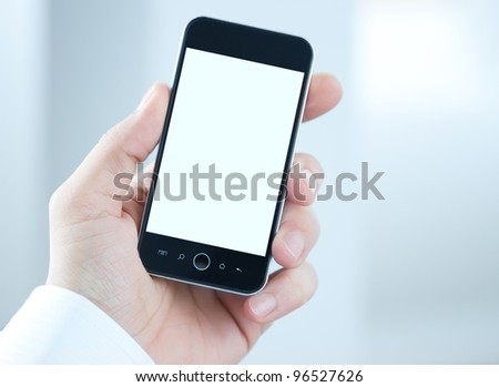 Male hand holding blank mobile smart phone with clipping path for the screen