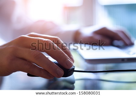 male hand holding computer...