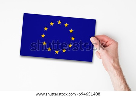Male hand holding european union flag #694651408